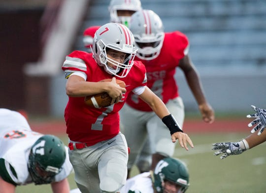 Bosse's Breylin Behme (7) carries the ball during the Bosse Bulldogs vs Vincennes Lincoln Alices game at Enlow Field Friday evening, Aug. 23, 2019.