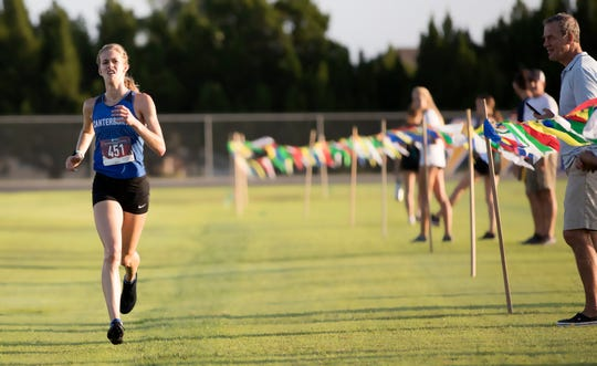 Canterbury School's Jessica Edwards races in the Lehigh Lightning Cross Country Invitational on Saturday at Lehigh Senior High School in Lehigh Acres. More than 40 teams from Lee, Collier and surrounding counties competed in the annual competition.