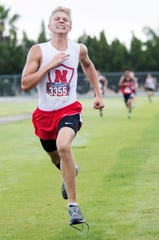 North Fort Myers High School's Mattias Flamholc races in the Lehigh Lightning Cross Country Invitational on Saturday at Lehigh Senior High School in Lehigh Acres. More than 40 teams from Lee, Collier and surrounding counties competed in the annual competition.