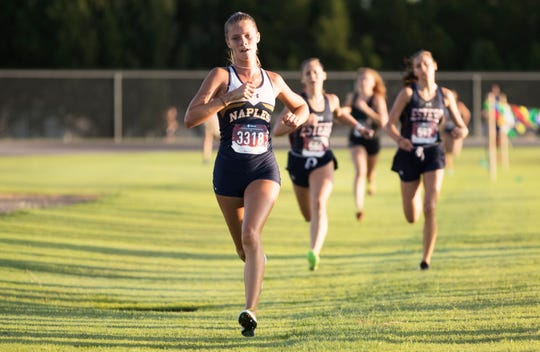 Naples High School's Morgan Vickaryous races in the  Lehigh Lightning Cross Country Invitational on Saturday at Lehigh Senior High School in Lehigh Acres. More than 40 teams from Lee, Collier and surrounding counties competed in the annual competition.
