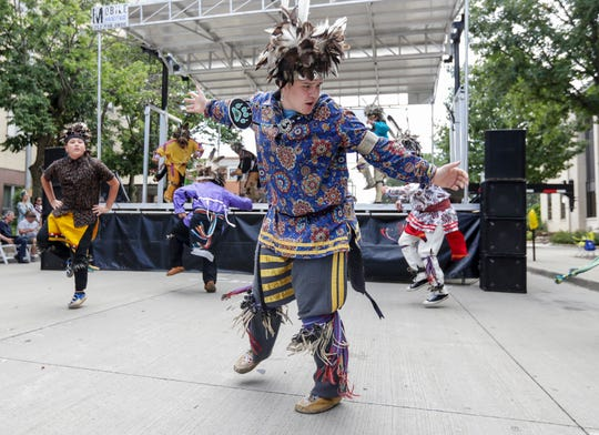 Marian University student Dylan Granquist will perform with the Oneida Nation Dancers and Drummer, at Marian University's Indigenous Peoples' Day Celebration. He is pictured performing the smoke dance with the Oneida Dancers during Artstreet Saturday, August 24, 2019, in Green Bay, Wis.