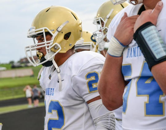 DW Daniel senior Nick Watt(22) and teammates get ready to run on the field before the game at Liberty High School in Liberty Friday, August 23, 2019.