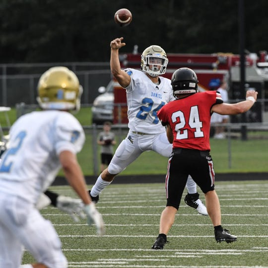 DW Daniel senior Tyler Venables(24) throws near Liberty senior David Patterson(24) during the first quarter at Liberty High School in Liberty Friday, August 23, 2019.
