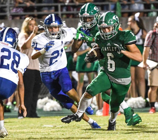 Easley senior Dylan Lyda(6) runs near Pickens defender Zander Gravely(21) during the third quarter at Easley High School in Easley Friday, August 23, 2019.