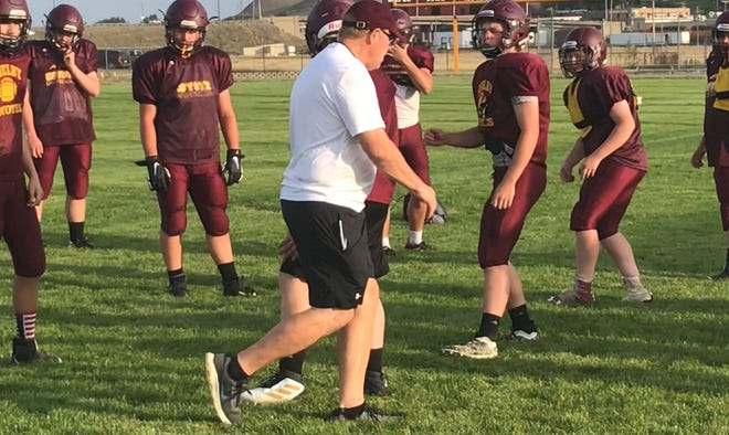 Shelby assistant coach Paul Schilling gives instructions on a defensive drill to his players during a practice this past week at the Coyotes' field.