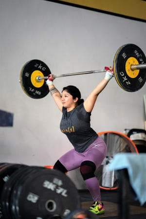 Dayanara Calma works out at the Chamorri Crossfit Gym in Tamuning. Calma will represent Guam at the world weightlifting championships.