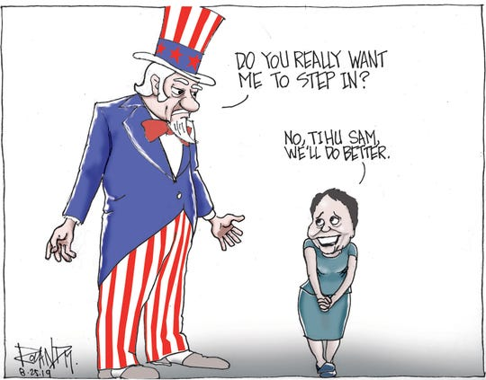 Sunday cartoon on Organic Act amendment for taxes.