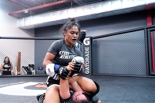 Miara Leon Guerrero secures her victory with superior wrestling and control over Myrika Guerrero during Glorified Sparring on Aug. 23 at Steel Athletics gym in Tamuning.