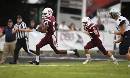 Henderson's Myekel Sanners (21) picks up big yards on a the opening kick-off as the Reitz Panthers play the Henderson County Colonels at Henderson's Colonel Field Friday evening, August 23, 2019.