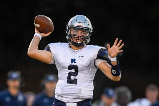 Reitz quarterback Reid Brickey (2) looks to pass as the Reitz Panthers play the Henderson County Colonels at Henderson's Colonel Field Friday evening, August 23, 2019.