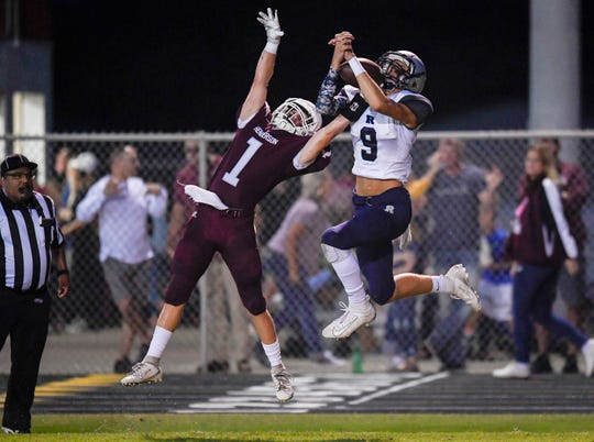 Henderson's Colton Evans (1) and Reitz's Jaydon Summers (9) battle for the ball in the end zone as the Reitz Panthers play the Henderson County Colonels at Henderson's Colonel Field Friday evening, August 23, 2019.