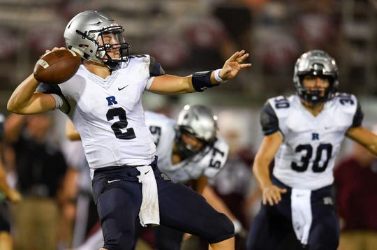 Reitz quarterback Reid Brickey (2) draws back to pass as the Reitz Panthers play the Henderson County Colonels at Henderson's Colonel Field Friday evening, August 23, 2019.