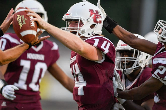 Henderson quarterback Sam Elliott (14) celebrates a first half touchdown as the Reitz Panthers play the Henderson County Colonels at Henderson's Colonel Field Friday evening, August 23, 2019.