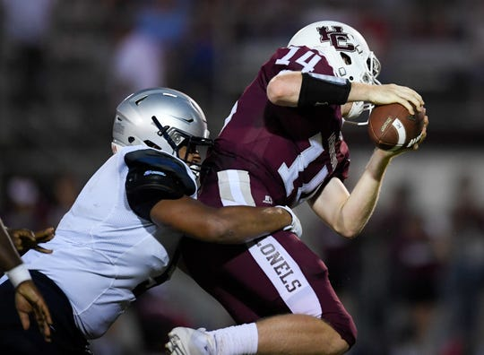 Reitz's Taylor Splittorff (5) sacks Henderson quarterback Sam Elliott (14) as the Reitz Panthers play the Henderson County Colonels at Henderson's Colonel Field Friday evening, August 23, 2019.