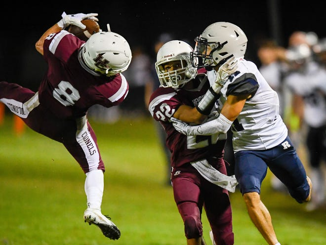 Henderson's Ben Dalton (8) intercepts a pass while receiver Reitz's Malachi Joy (11) and Henderson's Edmund Brooks (22) battle as the Reitz Panthers play the Henderson County Colonels at Henderson's Colonel Field Friday evening, August 23, 2019.