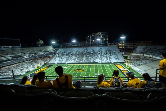 This photo from August 2019 shows freshman students getting a tour of Kinnick Stadium at night. So far, Iowa is operating as if there will be no fan restrictions for the 2020 season but department leaders know that could change.