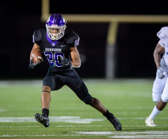 Brownsburg High School senior Donny Marcus (20) runs for a first down during the second half of action. Brownsburg High School hosted Ben Davis High School in varsity football action Friday, Aug. 23, 2019. Brownsburg won 29-24.