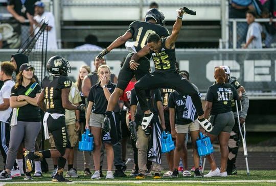 Warren Central runner back Randy Wells (10) celebrates with Damon Massie (25) after scoring a touchdown against Center Grove, at Warren Central High School, Friday, August 23, 2019, Indianapolis. Warren Central defeated Center Grove, 21-14.