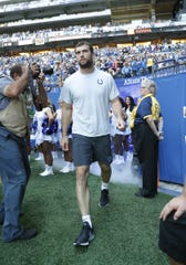 Indianapolis Colts quarterback Andrew Luck (12) walks onto the field in the first quarter of their preseason game at Lucas Oil Stadium on Saturday, Aug 24, 2019.