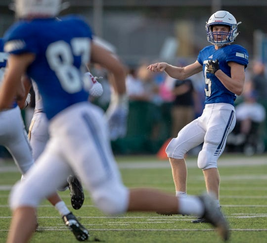 Kyle Cheek, quarterback for Bishop Chatard High School watches the pass' intended target, Indianapolis, Friday, Aug. 23, 2019. Bishop Chatard beat Brebeuf Jesuit Preparatory School 49-14 in week one of the high school football season.
