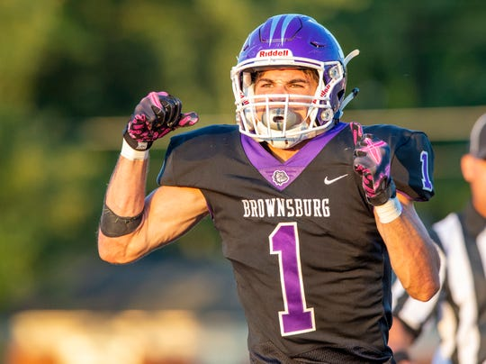 Brownsburg High School junior Preston Terrell (1) celebrates a touchdown reception with less than a minute left to play in the first half of action. Brownsburg High School hosted Ben Davis High School in varsity football action Friday, Aug. 23, 2019.