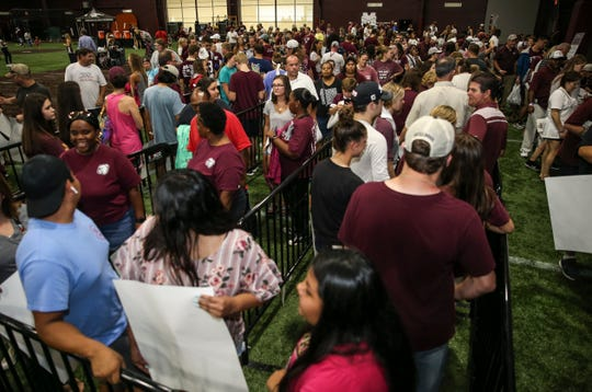 Mississippi State fans showed up in bunches for the football program's annual fan day, which took place one day after the NCAA placed MSU on probation for three years.