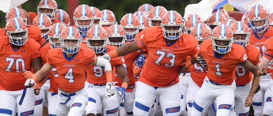 The Madison Central Jaguars take the field at Warren Central High School in Vicksburg, Miss., on Friday, August 23, 2019.