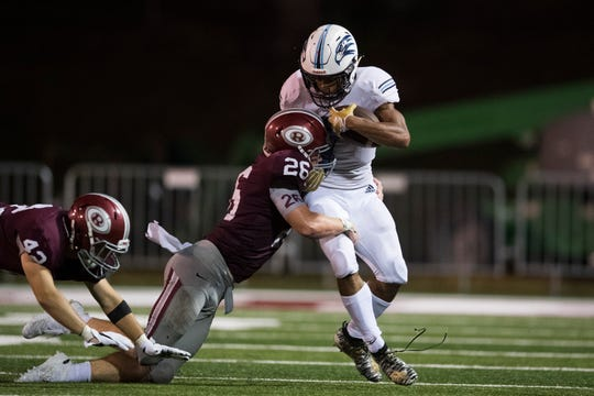 Oak Ridge's Matthew Calhoun (42) and Jack Replogle (26) take down Hardin Valley's Kelton Gunn (7) during a Week 1 game.