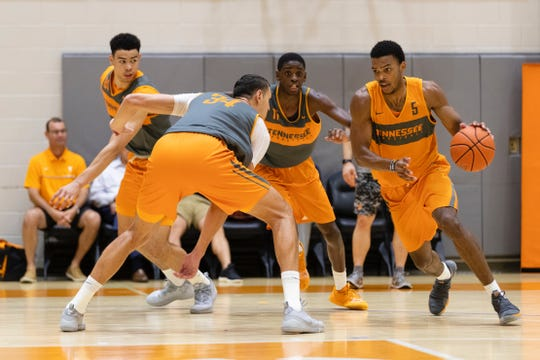 Tennessee guard Josiah-Jordan James dribbles around Uros Plavsic during a summer workout at Pratt Pavilion in Knoxville, Tennessee.