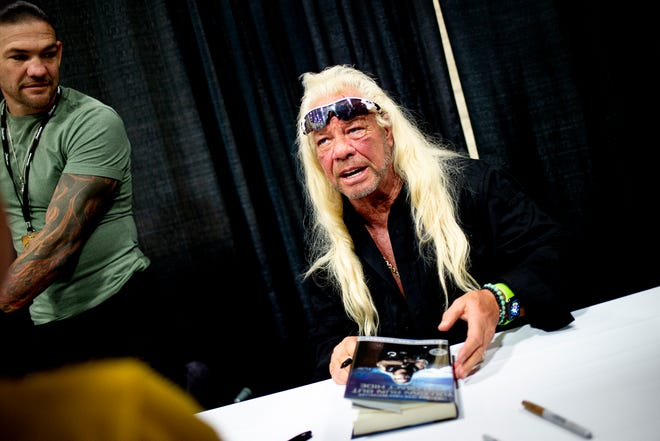 """Duane Lee """"Dog"""" Chapman signs an autograph for a fan at Bubba Fest at the Knoxville Convention Center in Knoxville, Tennessee, on Saturday, August 24, 2019."""