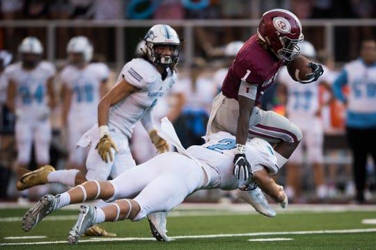Oak Ridge's Kendall Jackson (1) is tackled by Hardin Valley's Luke Filipkowski (2) during a TSSAA high school football game between Oak Ridge and Hardin Valley at Oak Ridge Friday, Aug. 23, 2019.