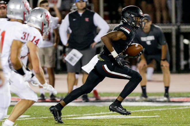 Lafayette Jeff wide receiver Derrick Matthews (2) runs the ball during the third quarter of an IHSAA football game, Friday, Aug. 23, 2019 at Scheumann Stadium in Lafayette. Lafayette Jeff won, 74-66.