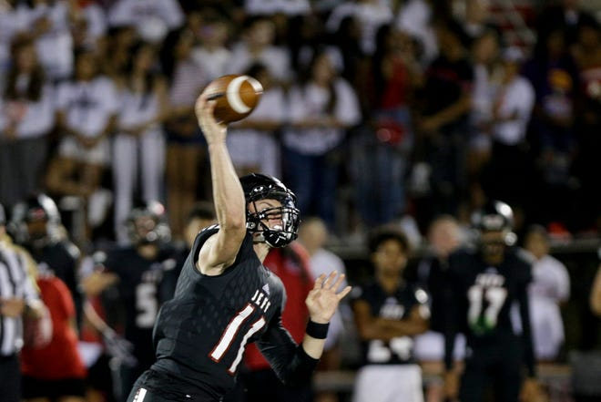 Lafayette Jeff quarterback Maximus Grimes (11) throws during the fourth quarter of a IHSAA football game, Friday, Aug. 23, 2019 at Scheumann Stadium in Lafayette. Lafayette Jeff won, 74-66.