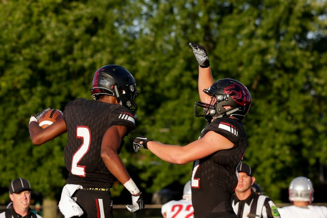 Brady Preston, right, celebrates a first-quarter touchdown by Derrick Matthews in Friday's win over West Lafayette.