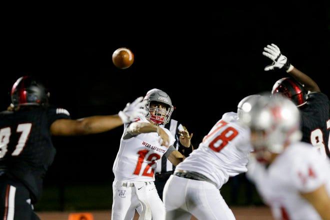 West Lafayette quarterback Kyle Adams (12) throws during the third quarter of an IHSAA football game, Friday, Aug. 23, 2019 at Scheumann Stadium in Lafayette. Lafayette Jeff won, 74-66.