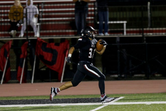 Marquis Munoz returns a West Lafayette onside kick for a touchdown, one of six TDs for the Lafayette Jeff senior in Friday's 74-66 win over West Lafayette.
