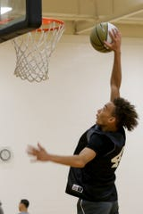 McCutcheon's Dravyn Gibbs Lawhorn (45) dunks during a Purdue Men's Basketball Elite Camp, Saturday, Aug. 24, 2019 at the Cordova Recreational Sports Center in West Lafayette.