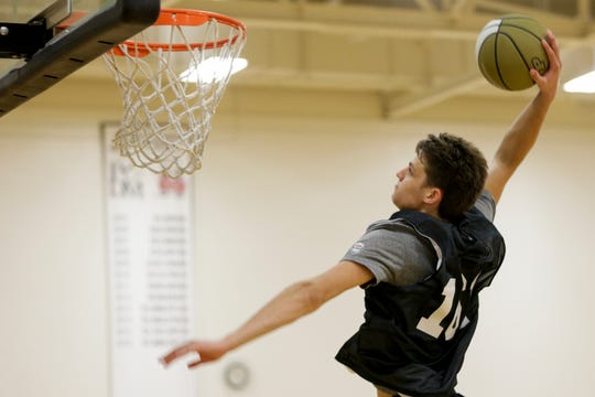 Wayzata's Camden Heide (161) goes up for a dunk during a Purdue Men's Basketball Elite Camp, Saturday, Aug. 24, 2019 at the Cordova Recreational Sports Center in West Lafayette.