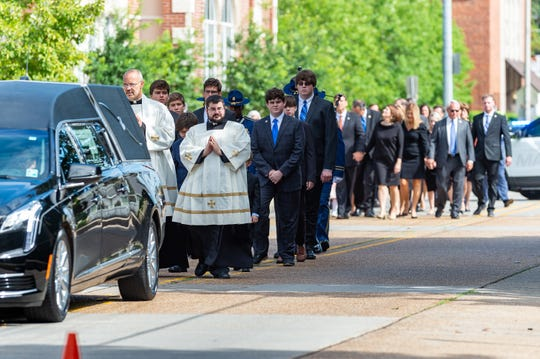 The family of Louisiana Governor Kathleen Babineaux Blanco walk behind hearse during Reflections and Mass of Christian Burial at  St John The Evangalist Cathedral in Lafayette, LA. Saturday, Aug. 24, 2019.