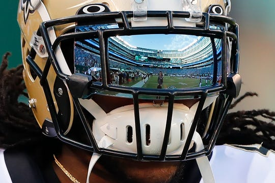 New Orleans Saints running back Alvin Kamara warms up before a preseason NFL football game against the New York Jets Saturday, Aug. 24, 2019, in East Rutherford, N.J. (AP Photo/Noah K. Murray)