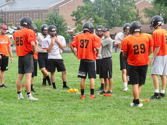 Amanda-Clearcreek coach Steve Daulton talks with his players during two-a-day practices. He led the Aces to an 8-3 record.