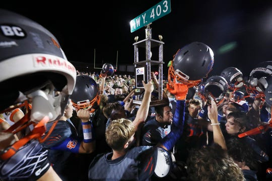 Silver Creek hoists the Hwy. 403 trophy after defeating Charlestown 13-7 at Silver Creek High School. Aug. 23, 2019.