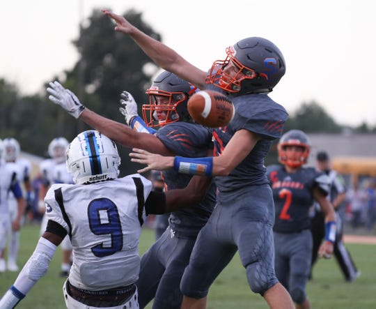 Silver Creek's Bryson Gatlin (12) and Jake Lucas (8) broke up a pass intended for Charlestown's Marion Lukes (9) during their game at Silver Creek High School. Aug. 23, 2019