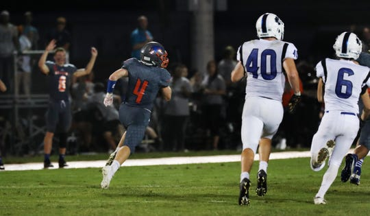 Silver Creek's Easton Messer (4) runs back a 70-yard punt to score the game winning touchdown against Charlestown for a 13-7 score at Silver Creek High School. Aug. 23, 2019