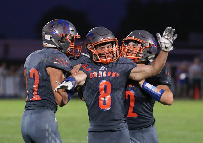 Silver Creek's Jake Lucas (8) celebrates after he caught a touchdown pass against Charlestown to tie the game at 7-7 at Silver Creek High School. Aug. 23, 2019