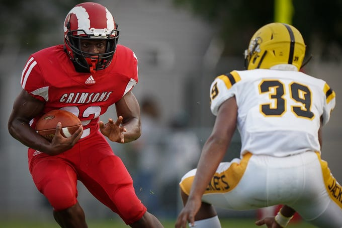 DuPont Manual running back Ja'Waun Northington runs with the ball during the football game played against Central High School in Louisville, Ky, Friday, August 23, 2019.