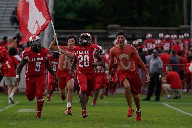 DuPont Manual players take the field before the football game played against Central High School in Louisville, Ky, Friday, August 23, 2019.