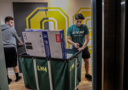 Several elevators in the 464 tenant Landmark Apartment in East Lansing are a help to students moving in on Saturday, Aug. 24, 2019.