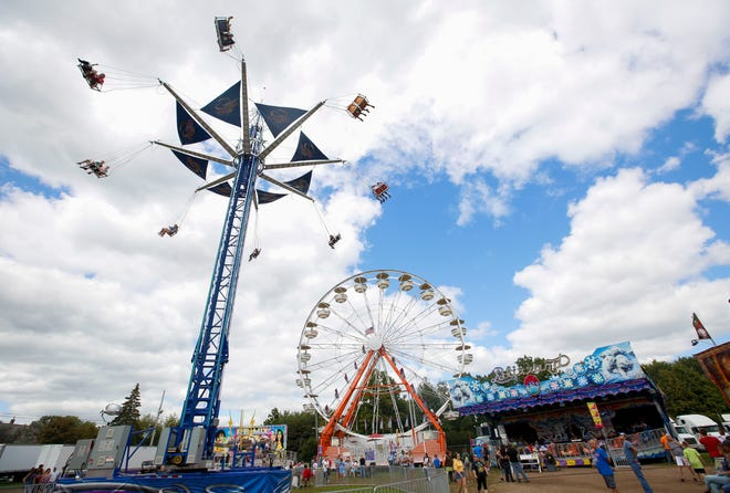 The Sky Hawk and ferris wheel tower over the midway on Saturday, August 24, 2019, at the Central Wisconsin State Fair in Marshfield, Wis. Tork Mason/USA TODAY NETWORK-Wisconsin