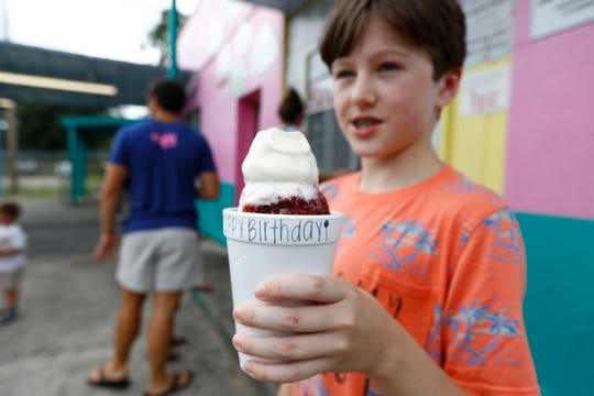 Simon Schoenberger celebrated his 13th birthday Saturday by trying the final flavor, blackberry, finishing his goal to taste every flavor of Jerry's Snow Cones.